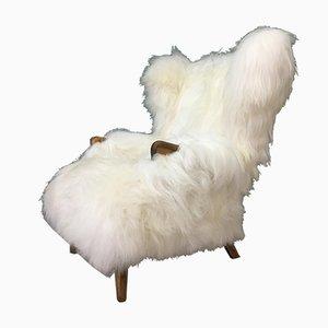 Butaca vintage de piel de oveja blanca de Parker Knoll