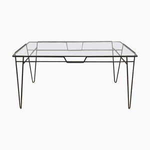 Mesa de comedor con patas de horquilla de metal negro y superficie de vidrio, años 60