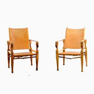 Vintage Cognac Leather Safari Lounge Chairs by Wilhelm Kienzle for Wohnbedarf, Set of 2