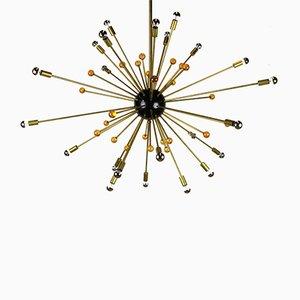 Lámpara de araña Sputnik italiana minimalista en negro, dorado y cristal de Murano al estilo de Stilnovo, años 50