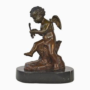 Antique Seated Cupid Sculpture from Moreau