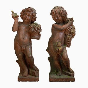 Stone Cast Spring and Autumn Allegorical Cherubs Sculptures, 1970s, Set of 2
