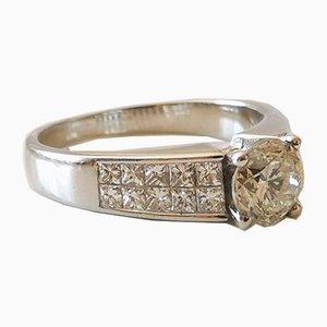 Solitario oro bianco diamante 1,2 carati e diamanti a taglio princess 1 carati