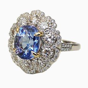 Goldener Ring aus 18 Karat Tansanit und Diamant von 4,1k
