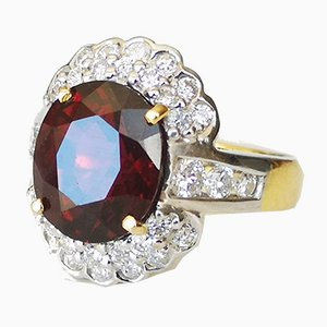 Gelbgoldener Ring 18 Karat rot-orangen Spinell 5,6 Karat und Diamanten