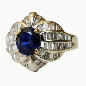 18 Karat White Gold Ring with Oval-Cut Sapphire Royal Blue and Setting of Diamonds