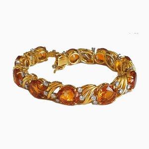 Goldfarbenes Armband mit Citrin und Diamanten verziert