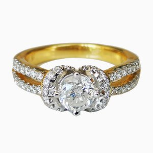 Ring in 18 Karat Gold with Central Diamond of 0.77 Karats and Setting of Diamonds