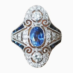 Gold Ring of 18 Karats in Art Deco Style Adorned with Sapphires and Diamonds