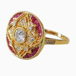 Art Deco Style Ring in 750 Yellow Gold with Diamond of 0.56 Karats with Rubies and Diamonds