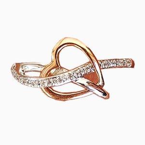 Ring in Gelbgold und 18 Karat Vergoldet aus ineinander verschlungenen Herzen