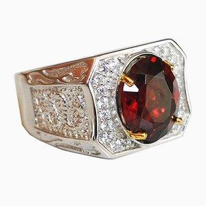 Ring aus 18 Karat Gold und Silber in der Mitte mit einem Granat von 4,23k in einem Pflaster aus weißen Steinen verziert