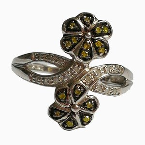 Silver Ring Decorated with Floral Motifs with Green Diamonds