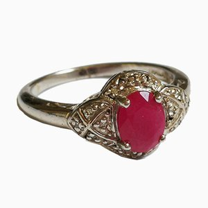 Ring with Oval Ruby ​​in a Circle of Diamonds