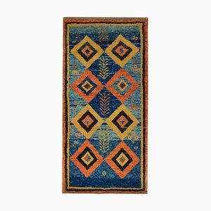 Lebendiger orientalischer Vintage Teppich aus Wolle