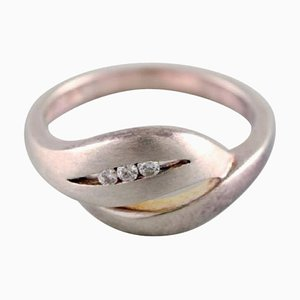 Sterling Silver Ring Adorned with Three Brilliants, 1970s