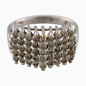 Large Art Deco Ring in 9 Karat White Gold with Numerous Diamonds