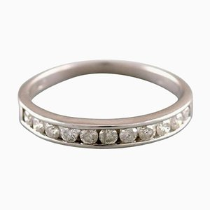 Classic Alliance Ring in 10 Karat White Gold with Numerous Diamonds