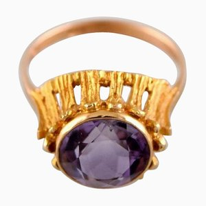 Swedish 18 Karat Gold Ring Adorned with Purple Semi Precious Stone, 1970s