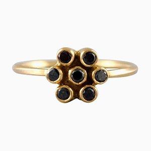 Carré Ring aus 18 Karat Gold in Form einer Blume mit 7 schwarzen Diamanten
