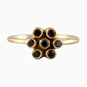 Carré Ring in 18 Karat Gold in the Form of a Flower Adorned with 7 Black Diamonds