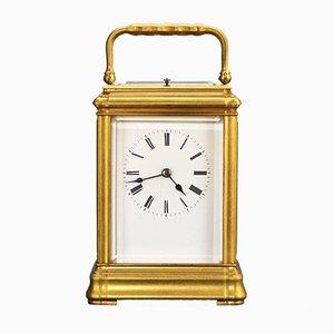 Orologio a forma di gola in ottone dorato con cassa da viaggio, 1885