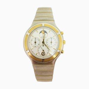 Reloj cronómetro de cuarzo con esfera de acero amarillo dorado de Eterna, años 90