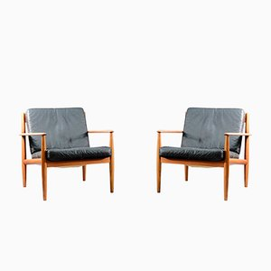 Mid-Century Danish Teak and Black Leather Lounge Chairs by Grete Jalk for France & Søn / France & Daverkosen, Set of 2