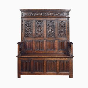 Carved Oak Settle in the 17th Century Style