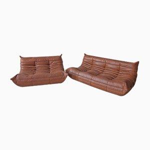 Juego de sofás Togo de dos plazas y tres asientos Kentucky de cuero marrón de Michel Ducaroy para Ligne Roset, años 70. Juego de 2