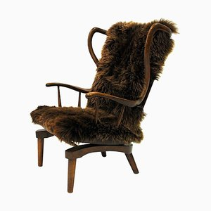 Danish Sheepskin Rocking Chair by Peter Hvidt, 1940s