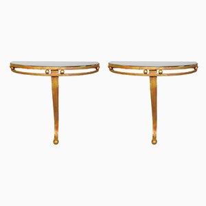 Consolle a mezzaluna in ferro battuto ed oro e vetro nero, anni '70, set di 2
