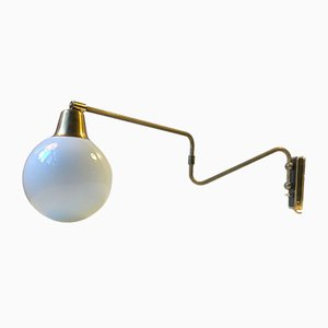 Danish Modern Brass Swing Arm Wall Light with Opaline Sphere from Laoni, 1960s