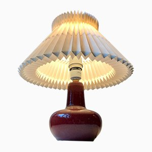 Danish Ceramic Oxblood Table Lamp by Ole Bøgild for Le Klint, 1970s