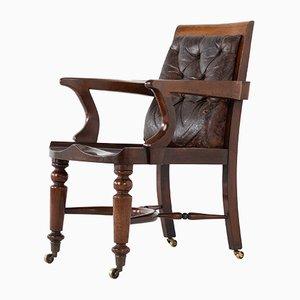 Silla de escritorio inglesa de caoba, siglo XIX con respaldo de cuero