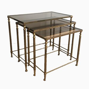 French Neoclassical Style Nesting Tables in Brass and Smoked Glass in the Style of Maison Jansen, 1940s