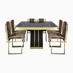 Sedie da pranzo Mid-Century in metallo dorato e tavolo da pranzo in legno laccato nero con finiture in ottone, anni '70, set di 7
