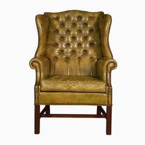 Antique Leather Upholstered Wingback Armchair