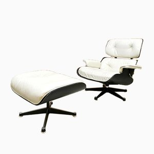Vintage Lounge Chair and Ottoman by Ray & Charles Eames for Herman Miller, 1950s, Set of 2