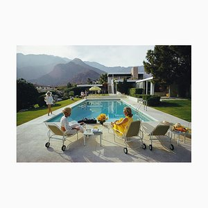 Poolside Gossip C Print Framed in White Wood by Slim Aarons