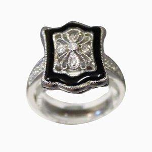 Anello in oro bianco 14kt con filigrana e piccoli diamanti