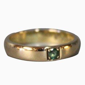 Schlichter 18 Karat Ring in Rotgold mit feinem grünem Smaragdschliff