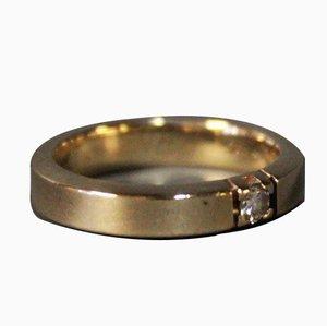 Schlichter 14 Karat Goldring mit kleinem Diamanten