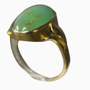 Anello in oro 14 kt con pietra taglio cabochon verde