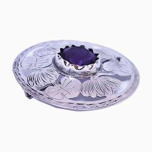 Broche 830 redondo de plata con piedra sintética alta morada