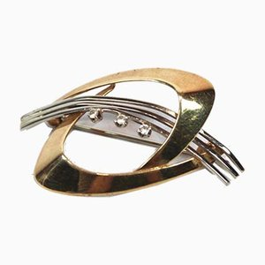 Broche de oro de 14 kilaras decorado con circonitas de HS