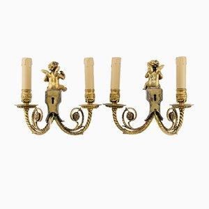 Apliques o apliques de querubín antiguos estilo neoclásico de bronce con dos brazos. Juego de 2
