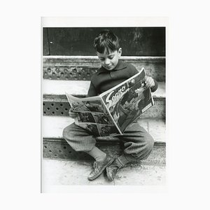 Boy Reading a Newspaper, Italy, 1956
