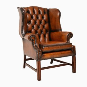 Deep Buttoned Leather Wing Back Armchair, 1950s