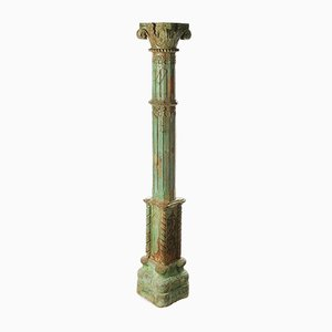 Stone Column and Carved and Patinated Wood